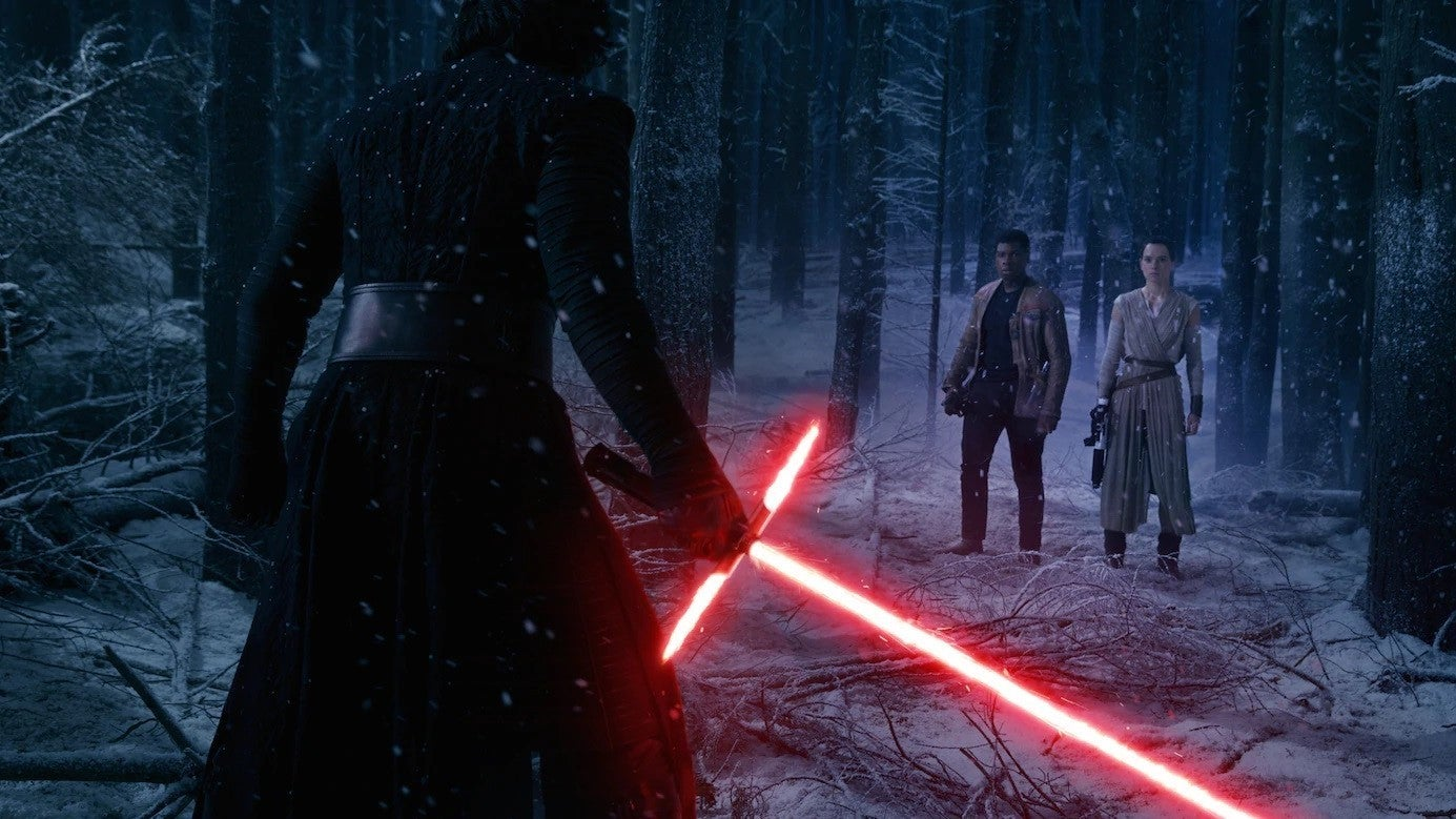 Kylo Ren with his lightsaber.
