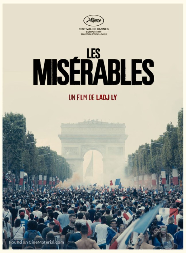 "Directors: A crowd of soccer/football fans celebrates in front of the arc de triomphe with the title ""Les Miserables"" over top"