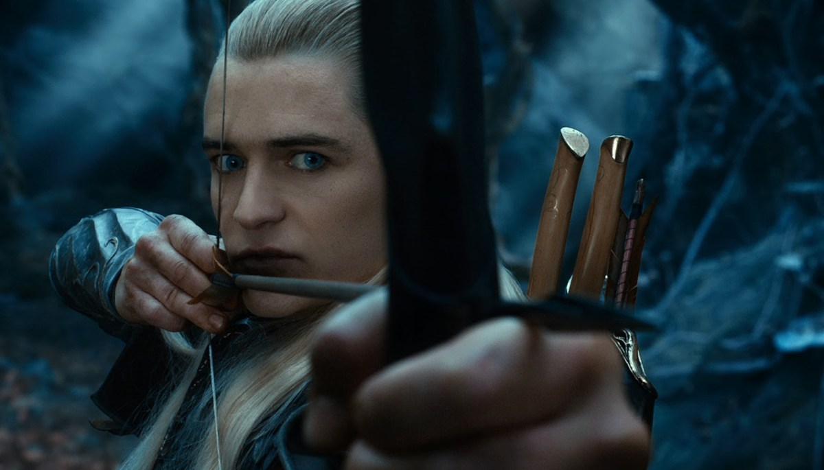 Legolas Greenleaf wielding a bow and arrow, one of the characters used in inuchick22's fanfiction.