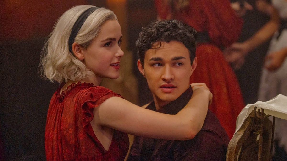 Sabrina Spellman and Nick Scratch, together in an embrace.