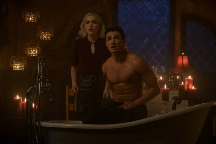 Nick sitting in a bathtub after going to a sunken ship for Sabrina.