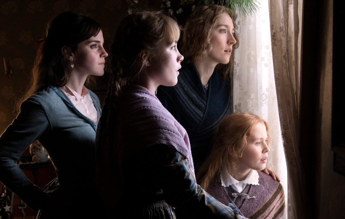 Little Women (2019): The March sisters in their home, staring out towards Laurie's home.