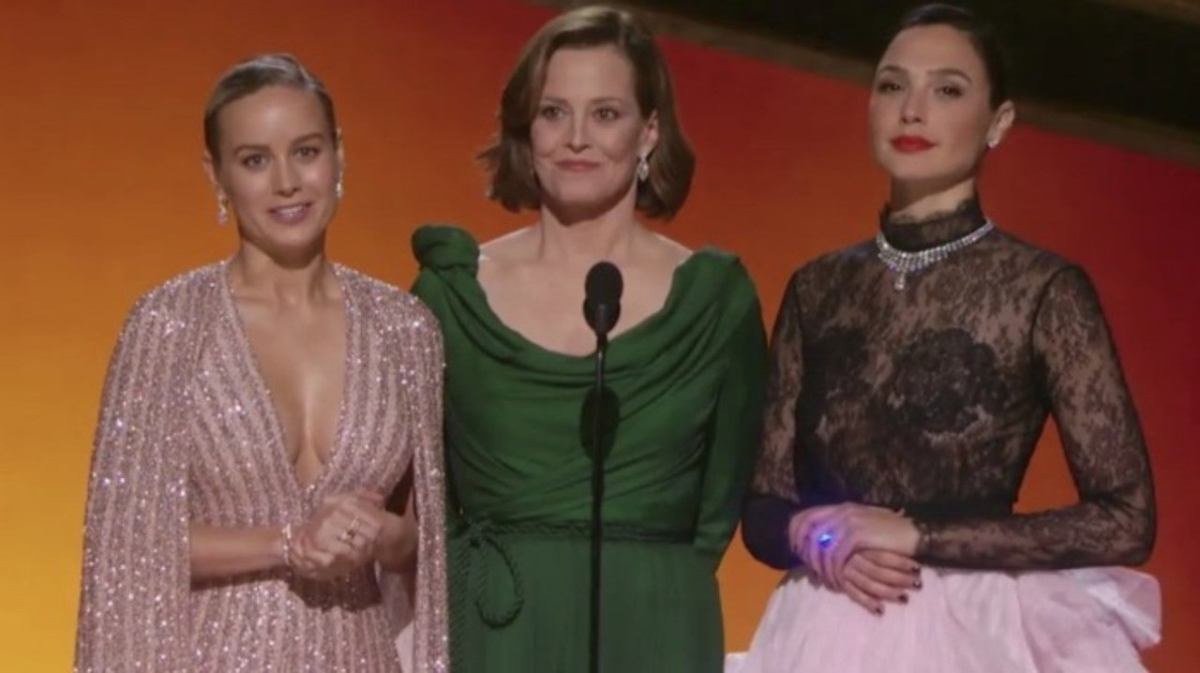 Brie Larson, Sigourney Weaver, and Gal Gadot present the award for Best Original Score for a Motion Picture.