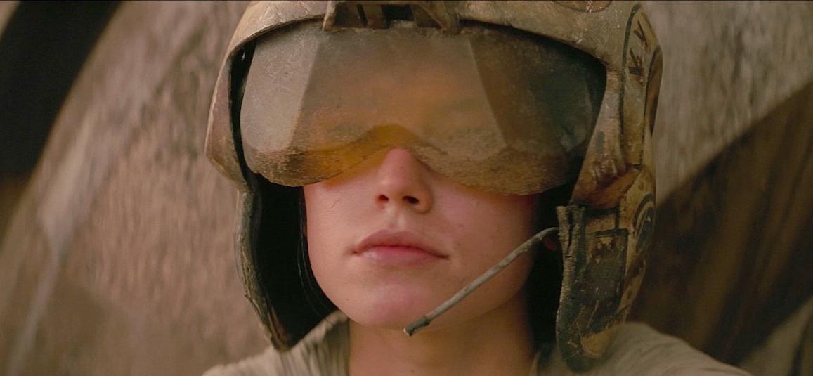 Jakku wearing a Rebel pilot flight helmet.
