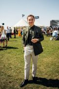 """GOODWOOD, WEST SUSSEX, ENGLAND - AUGUST 5: British actor Finn Cole attending the celebration of the official start of the """"Silver Spitfire - The Longest Flight"""" expedition in Goodwood. To the roaring applause of more than 400 guests, the carefully restored and polished Spitfire aircraft embarked on its unprecedented flight around the world (Photo by Remy Steiner/Getty Images for IWC)."""