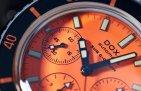 798.10.351.10 (orange dial, stainless steel bracelet)