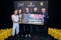 Depeche Mode and Ricardo Guadalupe hand over the check to Scott Harrisson from charity water association
