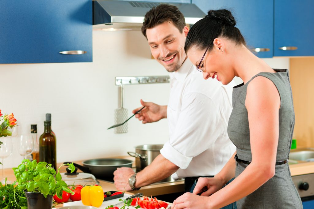 Young couple cooking - man