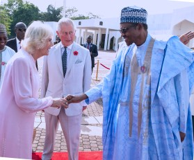 PRESIDENT BUHARI RECEIVED PRINCE CHARLES AND WIFE 0A&B. R-L; President Muhammadu Buhari, in a handshake with Princess Camilla and the Royal Highness, Prince Charles as they departs after the visit to State House in Abuja.