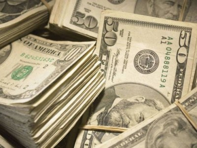 Dólar fecha em queda após acordo parcial em guerra comercial