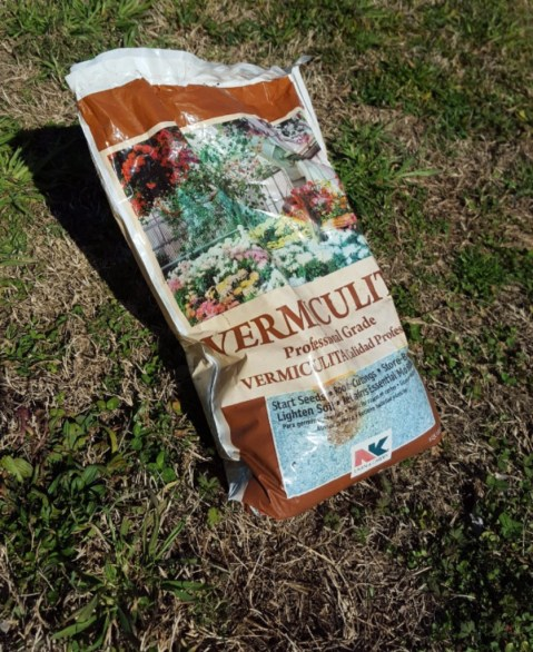 Vermiculite is a great choice for covering seeds. It is very light-weight and super absorbent.