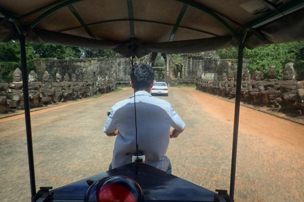 Riding in a Tuk Tuk on a temples tour
