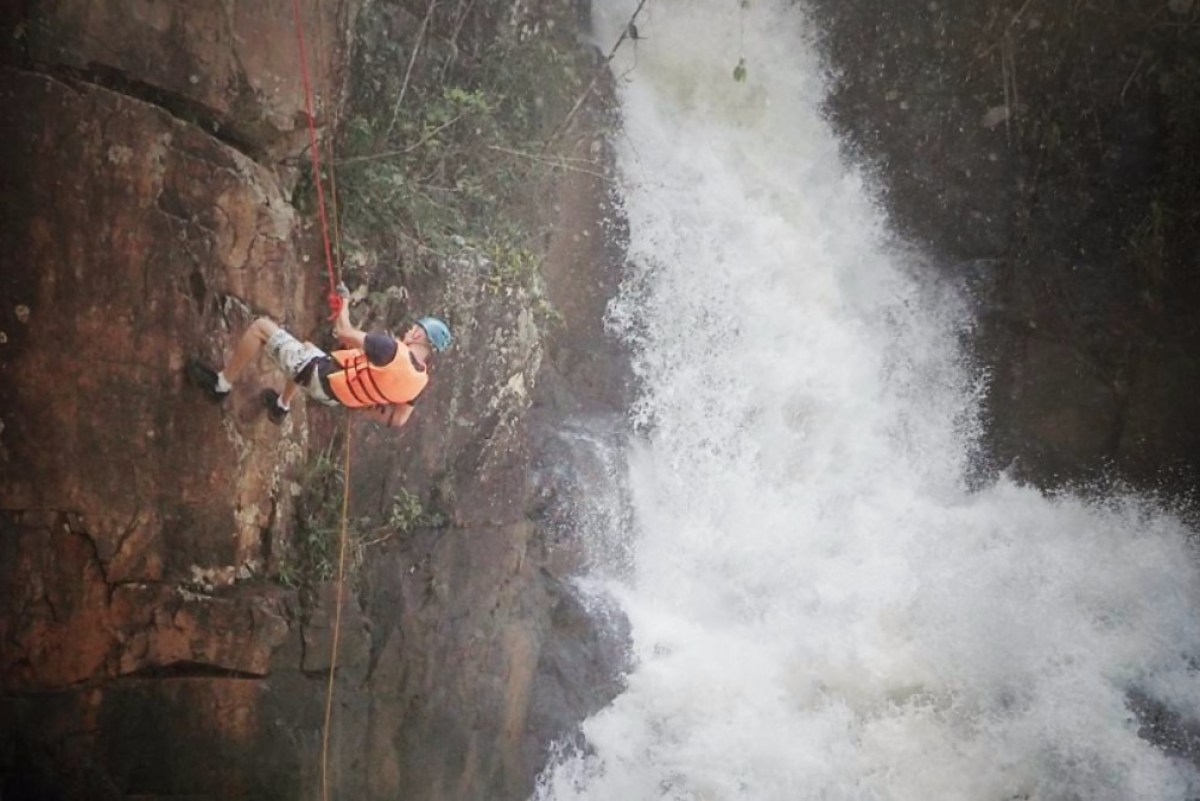 repelling down a cliff on the canyoning tour