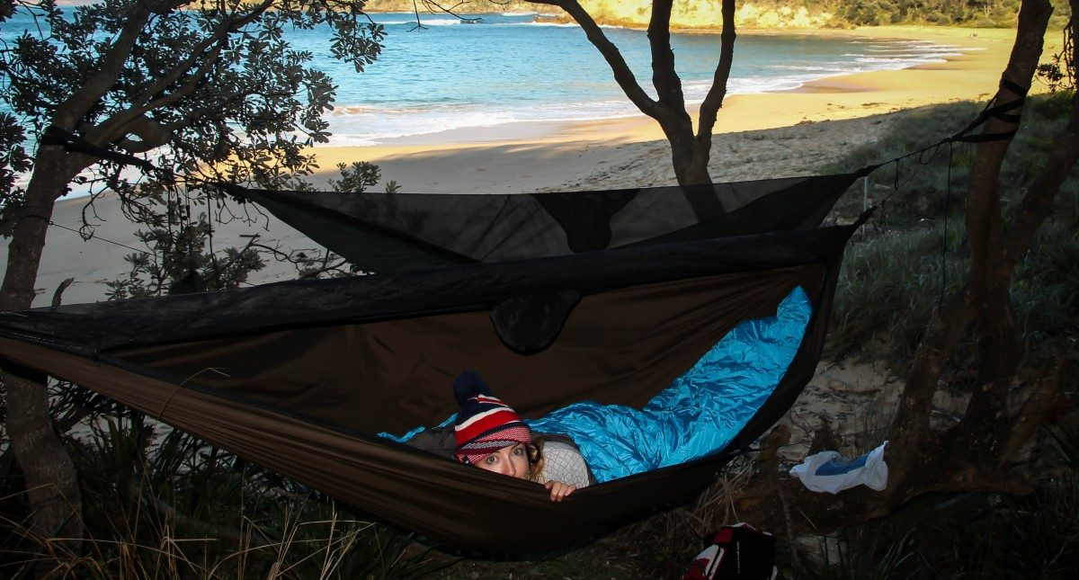 Top 6 Sydney Camping Escapes (by Public Transport), Henry Brydon, Royal National Park, hammock, woman, trees, beach, camping, sleeping bag, maitland bay