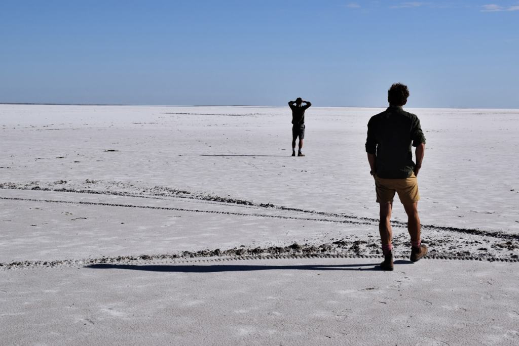 The Twins who Flew to the Australian Red Pole Henry Brydon, salt desert, twins, two men, tracks, horizon