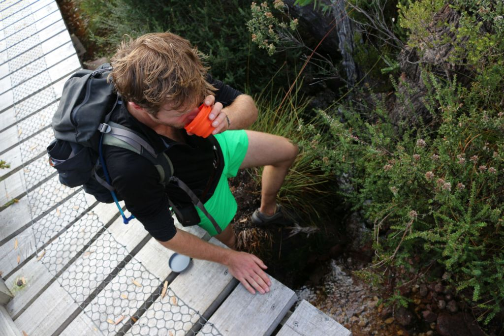 Tasmania Local Food Georgina Smyth, hiker, man, drinking, water