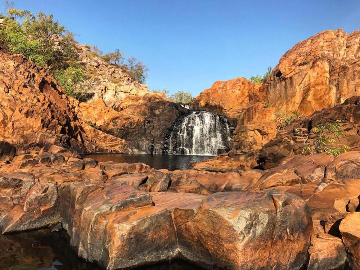 A Top End Wild Swimming Adventure NT Tiffany Hulm, Edith Falls, waterfall, red rocks, swimming hole, hero
