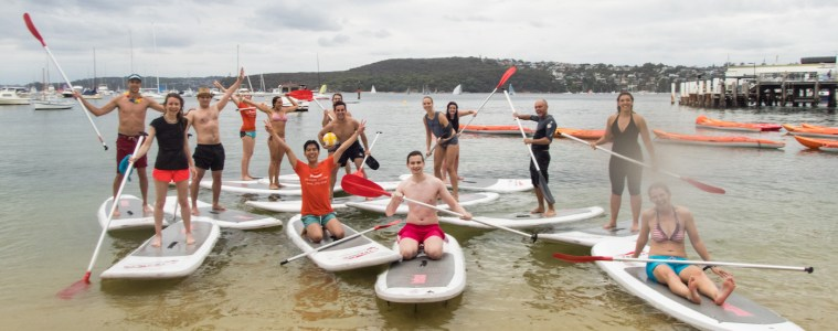 SUPBall // The Hybrid Sport For People Who Love Water (And Balls), Rebecca Burton, SUPball Team, paddles, group, cheer, watersport