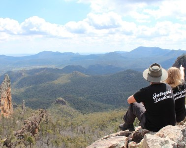 Why You Should Get Out And Give Back, Brooke Nolan, Intrepid Landcare, Warrumbungles, view, lookout akubra, feather in your hat, mountains, clouds, boulders, volunteering