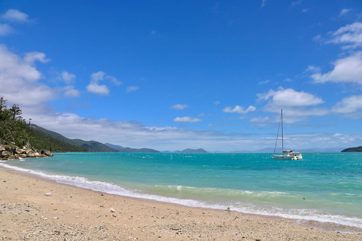 Camping The Whitsundays // Cairn Beach Campground (QLD), Solaye Snider, beach, turquoise, ocean, boat, sand, shore