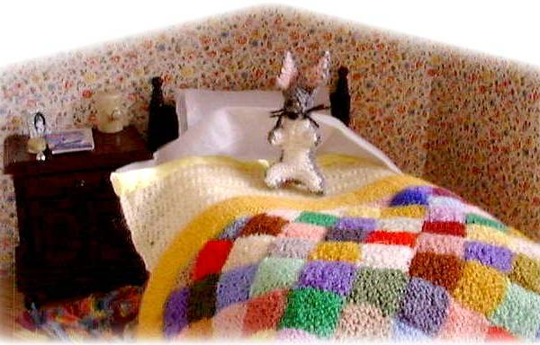 miniature bedclothes and toy