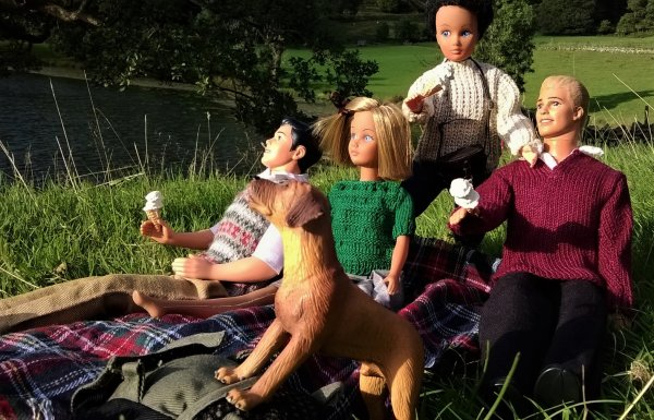dolls wearing knitted clothes