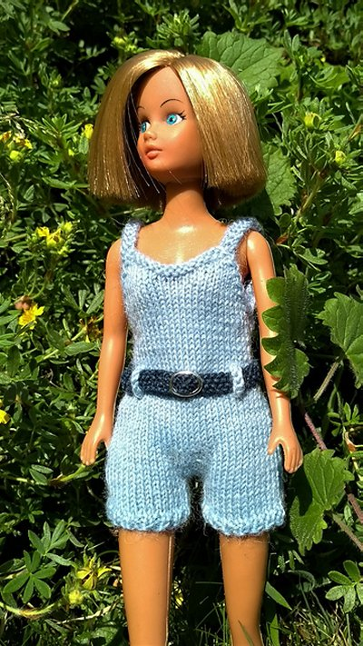 Doll in knitted swimsuit