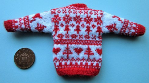 back of miniature knitted jumper
