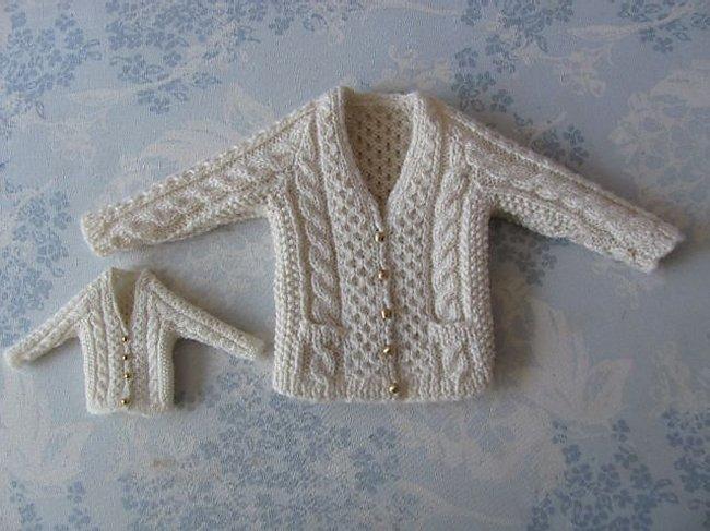 Miniature knitted Aran cardigans