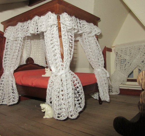 Miniature knitted bed hangings