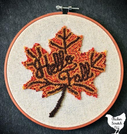multicolored punch needle autumn leaf with HEllow fall embroidered in the center