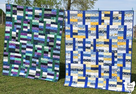 two jelly roll quilts hanging on a clothesline