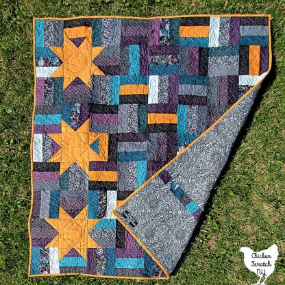front and back view of rail fence quilt with stars showing pieced backing