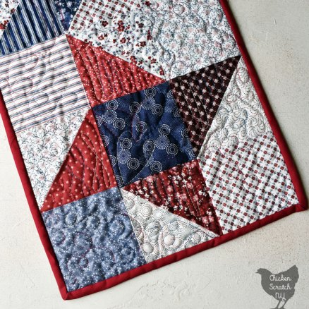 friendship star block in red, white and blue quilted table runner