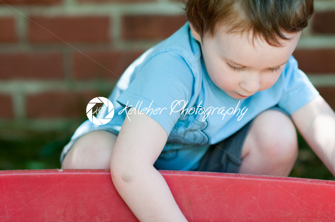 Adorable little boy playing in a sandbox - Kelleher Photography Store