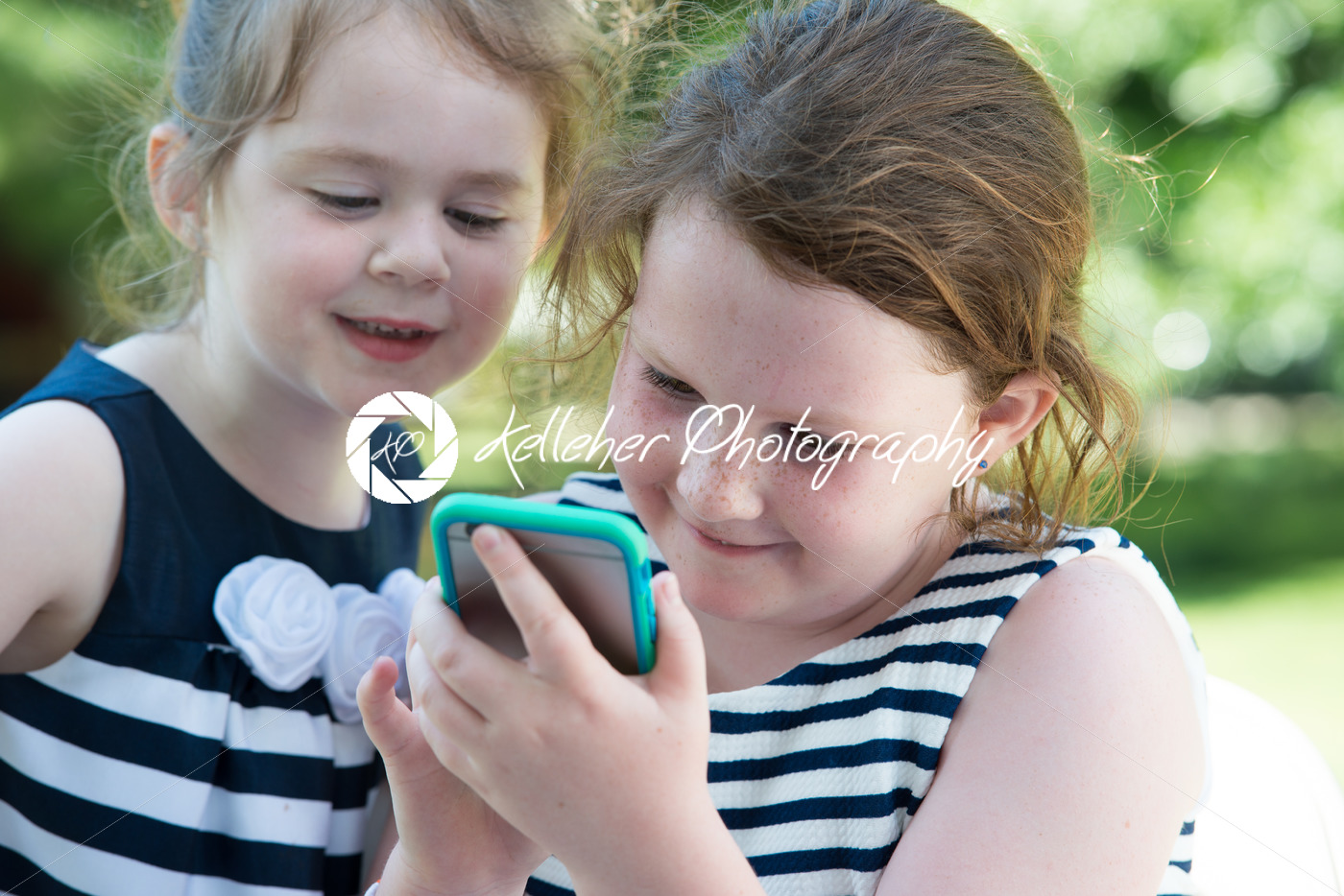 Happy Laughing Children Playing with Smartphone Outside - Kelleher Photography Store