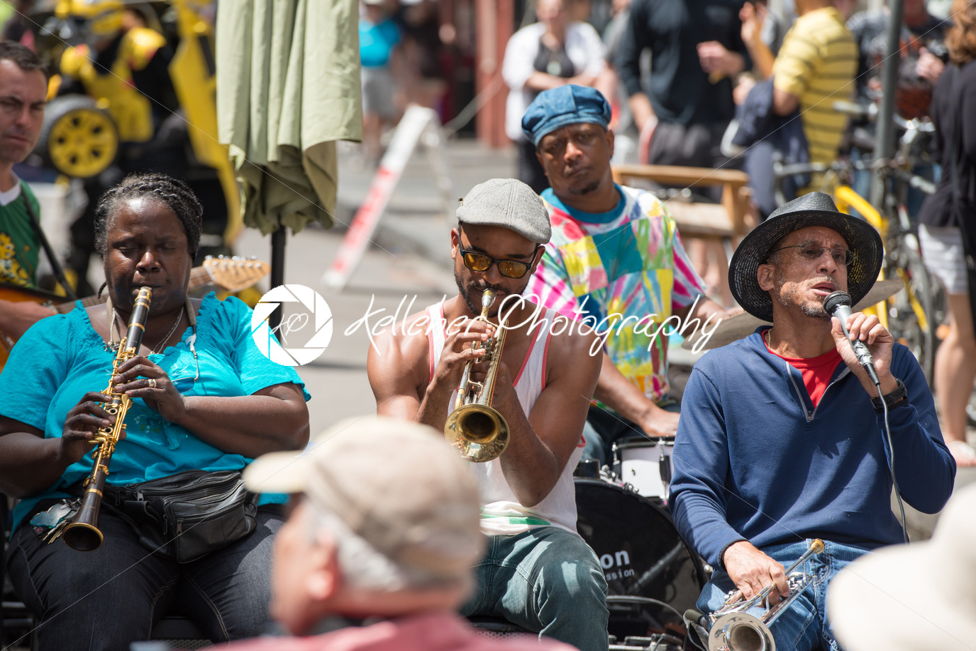 NEW ORLEANS – APRIL 13: In New Orleans, a jazz band plays jazz melodies in the street for donations from the tourists and locals passing by on April 13, 2014 - Kelleher Photography Store