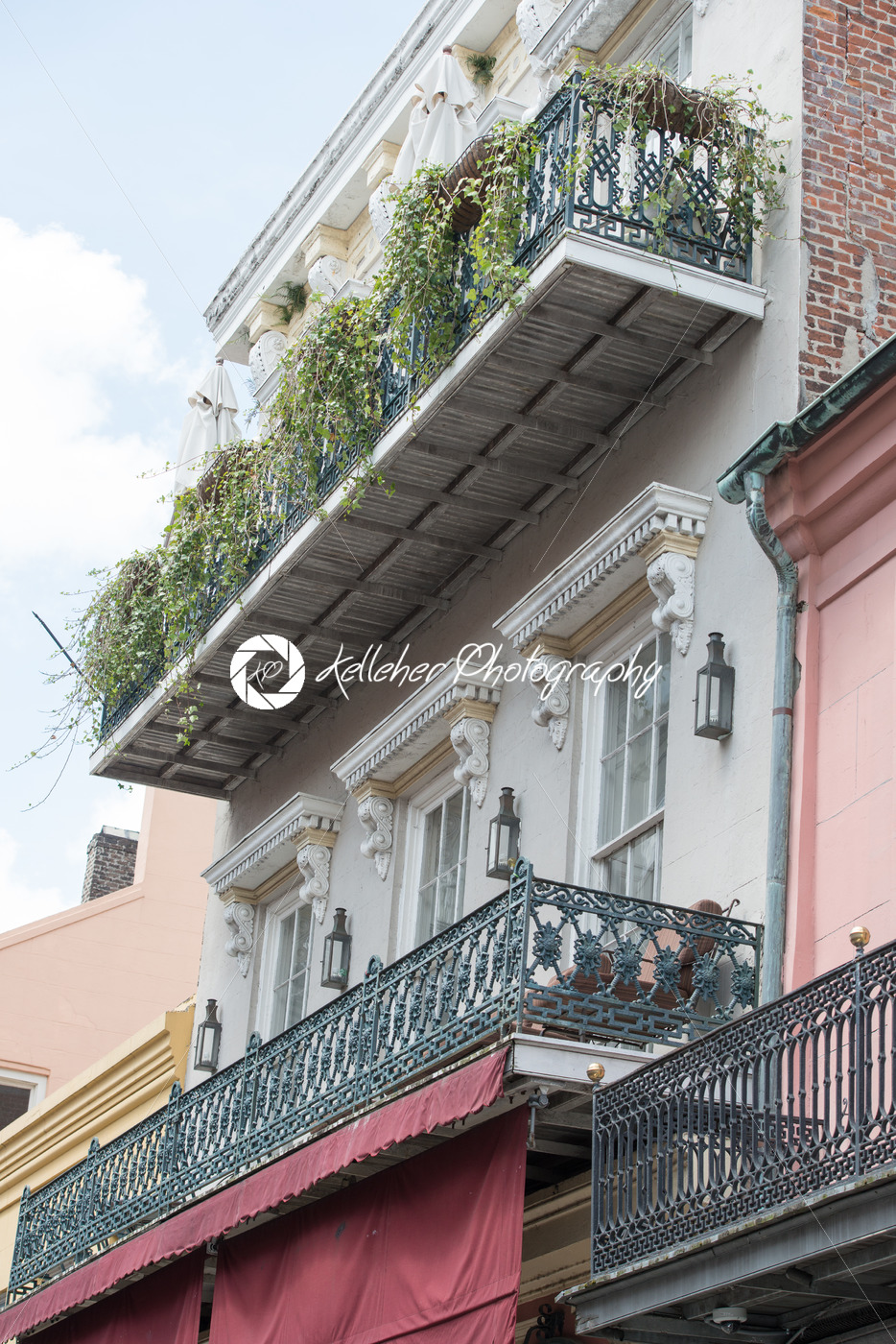NEW ORLEANS, LA – APRIL 13: Street in the French Quarter of New Orleans, Louisiana showing historic buldings with unique architecture on April 13, 2014 - Kelleher Photography Store