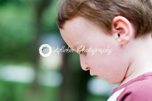 Young boy playing outside in back yard - Kelleher Photography Store