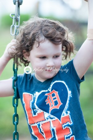 Young girl having fun on a swing set - Kelleher Photography Store