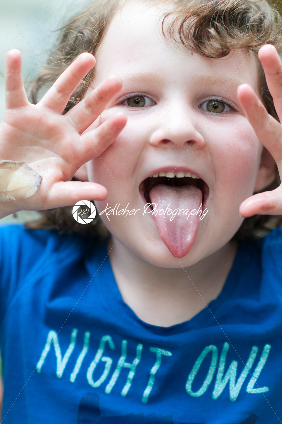 Young girl outside sticking out her tongue - Kelleher Photography Store