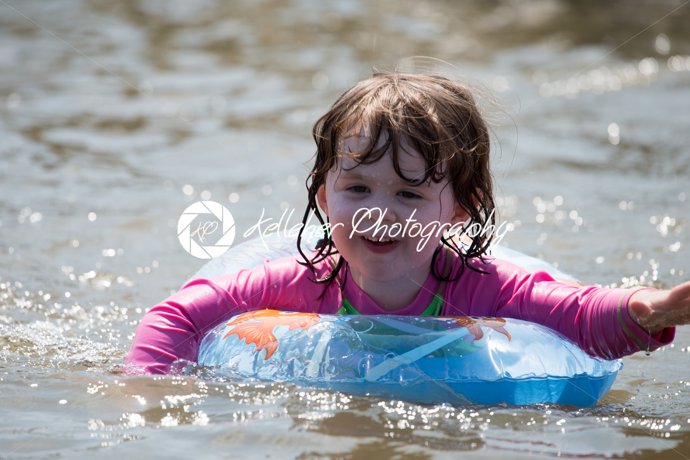 young girl floating in inner tubes in a blissful state - Kelleher Photography Store
