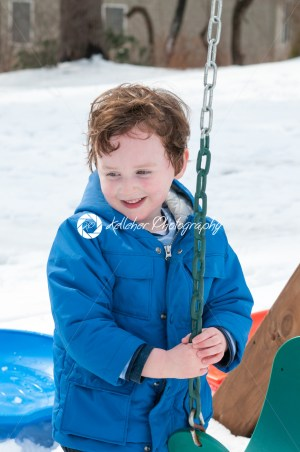 Happy toddler boy in warm coat on on snow day and having a fun in the winter outside, outdoor portrait - Kelleher Photography Store