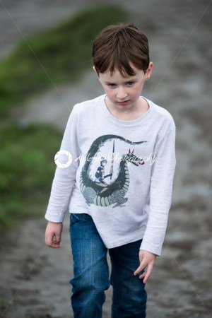 Boy walking up the Cliffs of Moher Tourist Attraction in Ireland - Kelleher Photography Store