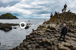 COUNTY ANTRIM, NORTHERN IRELAND – AUGUST 27, 2017: Group of tourists exploring the Giant's Causeway - Kelleher Photography Store