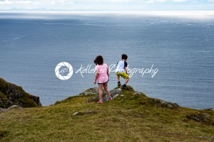 Girl and Boy looking out over Slieve League Cliffs, County Donegal, Ireland - Kelleher Photography Store