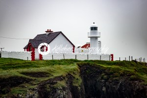 The lighthouse on a cliff in Dingle, Ireland - Kelleher Photography Store