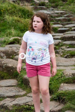 Young Girl walking on the rocks at Giant's Causeway - Kelleher Photography Store