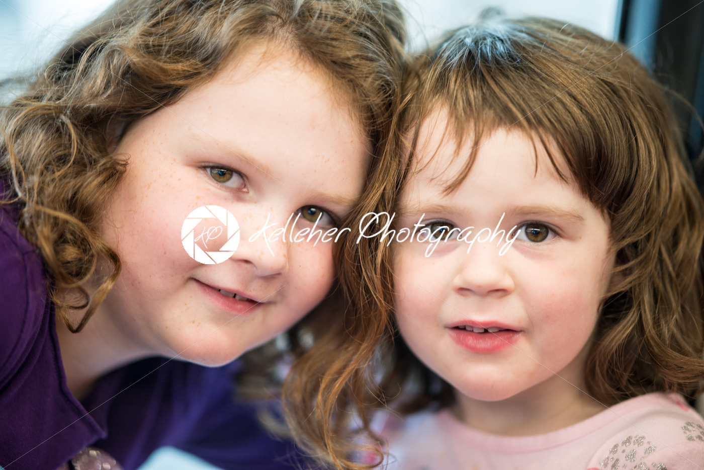Young sibling girls portrait looking and smiling at the camera. - Kelleher Photography Store