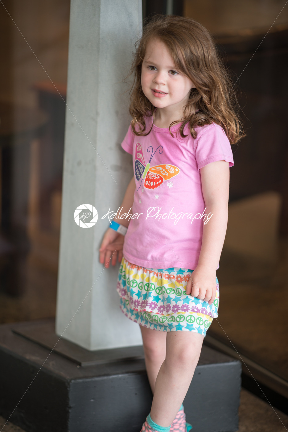 Cute young girl wearing pink top - Kelleher Photography Store
